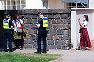 MELBOURNE, VIC - SEPTEMBER 19: A woman films whilst getting questioned by Victoria Police during the Freedom protest on September 19, 2020 in Melbourne, Australia. Freedom protests are being held in Melbourne every Saturday and Sunday in response to the governments COVID-19 restrictions and continuing removal of liberties despite new cases being on the decline. Victoria recorded a further 21 new cases overnight along with 7 deaths. (Photo by Mikko Robles/Speed Media)