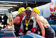 Aug 9, 2020; Clermont, Indiana, USA; NHRA top fuel driver Steve Torrence celebrates with family after winning the Indy Nationals at Lucas Oil Raceway. Mandatory Credit: Mark J. Rebilas-USA TODAY SportsDodge NHRA Indy Nationals presented by Pennzoil