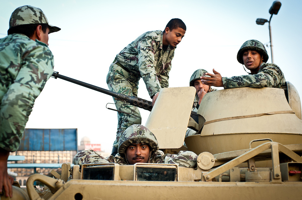 Egyptian army soldiers stand guard at the Qasr El Nil Bridge linking Tahrir Square with the Zamalek neighborhood of Cairo, the day after protesters successfully brought down the regime of President Hosni Mubarak, who ruled the country for thirty years.