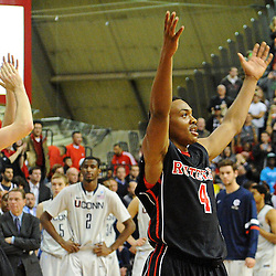 Rutgers Scarlet Knights guard Myles Mack (4) and forward Gilvydas Biruta (55) celebrate Rutgers' 67-60 upset victory over #8 UConn in NCAA Big East Basketball action at the Louis Brown Athletic Center in Piscataway, N.J. on Jan 7, 2012.