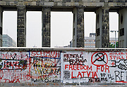 Graffiti, including Freedom for Latvia,  on Berlin Wall at Brandenberg Gate, Berlin, Germany.