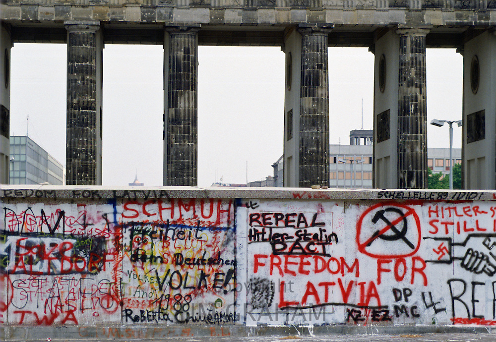 Graffiti, including Freedom for Latvia,  on Berlin Wall at Brandenberg Gate, Berlin, Germany.