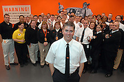 PHOTO PROVIDED BY GEEK SQUAD--Geek Squad  founder and chief inspector Robert Stephens joins agents Wednesday, Oct. 25, 2006, inside Geek Squad City, a state-of-the-art computer repair facility near Louisville, Ky. Stephens was on hand to celebrate the grand opening of the four acre complex. (Geek Squad/Brian Bohannon)