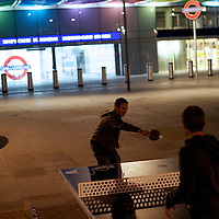 James Spencer and Tome Jeffery, from Kent, England, play table tennis at 4am outside St. Pancras International Station during the 2012 London Summer Olympics.