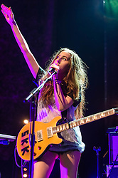 © Licensed to London News Pictures. 09/12/2013. London, UK.   Haim performing live at The Forum. In this pic - Alana Haim.  Haim is an American indie rock band consists of sisters Este Haim (bass/vocals), Danielle Haim (guitar/vocals) and Alana Haim (guitar/vocals/keyboards) with drummer Dash Huttong<br /> <br /> Haim were nominated in the Brand New for 2013 category in the 2013 MTV Music Awards, and won the Sound of 2013 category in the BBC Sound of 2013 awards. <br /> <br /> Photo credit : Richard Isaac/LNP