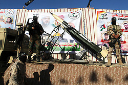 September 26, 2016 - Rafah, Gaza Strip, Palestinian Territory - Palestinian militants from the Al-Nasser Brigades, an armed wing of the Popular Resistance Committees (PRC), stand next to home-made rockets during a rally in Rafah in the southern Gaza Strip on September 26, 2016, to mark the 17th anniversary of the creation of their group  (Credit Image: © Abed Rahim Khatib/APA Images via ZUMA Wire)