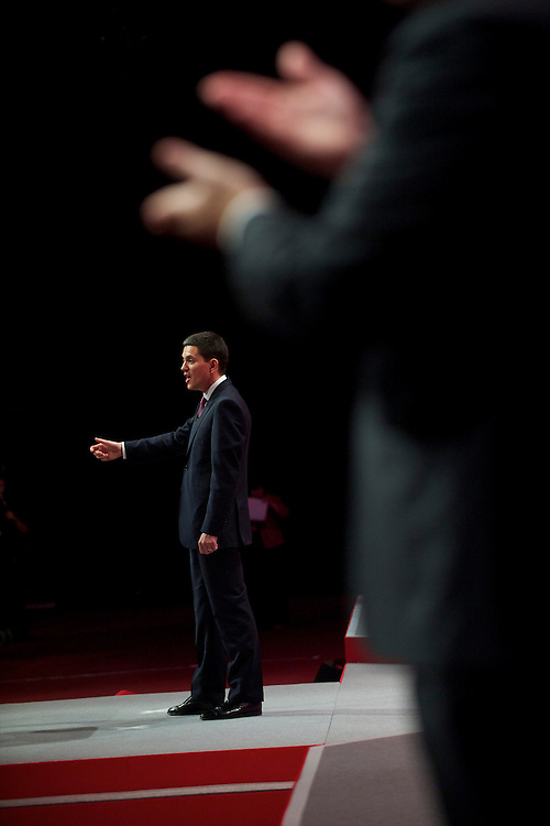 With sign language taking place above, David Miliband delivers a speech to delegates attending the Labour Autumn Conference in Manchester on 27 September 2010.
