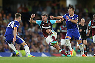 Andy Carroll of West Ham United holds off John Terry, the Chelsea captain. Premier league match, Chelsea v West Ham United at Stamford Bridge in London on Monday 15th August 2016.<br /> pic by John Patrick Fletcher, Andrew Orchard sports photography.