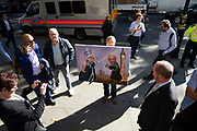 Satirical artist Kaya Mar with one of his paintings depicting the Queen and Speaker of the House having sword fight, stands outside the Supreme Court on day one of the hearing to rule on the suspension of parliament, on September 17th 2019 in London, United Kingdom.  Supreme Court judges will decide if Prime Minister Boris Johnson acted unlawfully in advising the Queen to prorogue parliament.