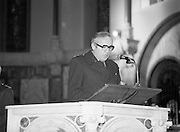 Garda Siochana Diamond Jubilee..1982.21.02,1982.02.21.1982.21st February 1982. .Image of a senior member of the Gardai reading a lesson at the mass in Mount Argus.