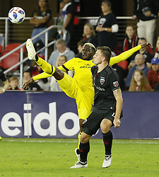 November 1, 2018 - Washington, DC, USA - Columbus Crew SC forward Gyasi Zardes (11) kicks the ball over D.C. United defender Frederic Brillant (13) during the first half of the MLS Cup knockout round playoff match at Audi Field in Washington, D.C., on Thursday, Nov. 1, 2018. (Credit Image: © Adam Cairns/Columbus Dispatch/TNS via ZUMA Wire)