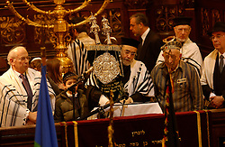 BRUSSELS, BELGIUM - JAN-30-2005 -  Sam Topor , 79, a survivor of the Auschwitz , Ebensee , and Mauthausen concentration camps, takes part in a memorial service with the help of Rabbi Albert Guigui at the Grand Synagogue in Brussels in remembrance of the liberation of the notorious Nazi concentration camp at Auschwitz. Topor lived in Antwerp before WWII and was captured by the Nazi's in Mechelen in 1942. (REPORTERS © JOCK FISTICK)