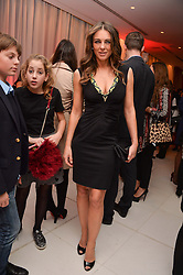 ELIZABETH HURLEY at a pre party for the English National Ballet's Christmas performance of The Nutcracker was held at the St.Martin's Lane Hotel, St.Martin's Lane, London on 12th December 2013.