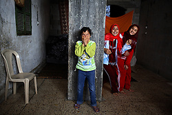 Huda Ghalia, 12, is seen with her siblings  inside their home in Gaza, Palestinian Territories, Nov. 17, 2006. Ghalia gained attention after members of her family were killed in an explosion that Palestinians say was caused by Israeli artillery fire, a charge Israel denies. According to Human Rights Watch, since September 2005, Israel has fired about 15,000 rounds at Gaza while Palestinian militants have fired around 1,700 back.