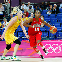 09 August 2012:  USA Tamika Catchings drives past Australia Lauren Jackson during 86-73 Team USA victory over Team Australia, during the women's basketball semi-finals, at the 02 Arena, in London, Great Britain.