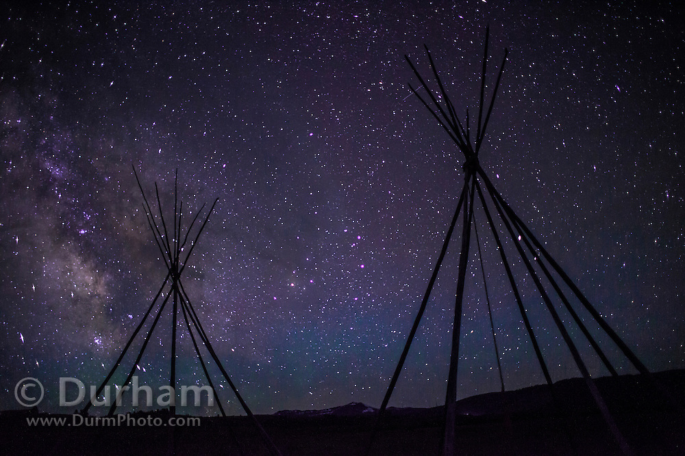 Tipi frames under a night sky from a Nez Perce encampment at Big Hole National Battlefield, Montana. The tipi frames represent the Nez Perce home and families that were present when the U.S. Cavalry attacked at pre--dawn in 1877 killing many women and children. Nez Perce warriors put up a fierce resistance and held the Cavalry at bay for two days while their people re-grouped and retreated from the Big Hole Valley.