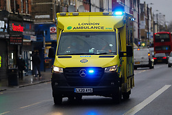 © Licensed to London News Pictures. 20/01/2021. London, UK. An ambulance responding to an emergency in north London.  On Tuesday 19 January, 1,610 people died in the UK within 28 days of a positive Covid-19 test. This is the biggest figure reported in a single day in the UK since the pandemic began last year. According to government figures over 4.2 million people have now received the first dose of a vaccine. Photo credit: Dinendra Haria/LNP