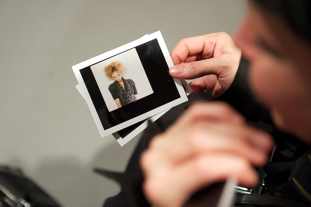 A stylist looks over a polaroid of a model before the Aminaka Wilmont spring 2011 fashion show at the On/Off venue in Bloomsbury Square, London on 17 September 2010.