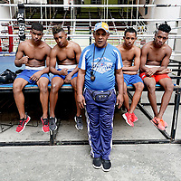 Boxing coach with his students, Old Havana, Cuba 2020 from Santiago to Havana, and in between.  Santiago, Baracoa, Guantanamo, Holguin, Las Tunas, Camaguey, Santi Spiritus, Trinidad, Santa Clara, Cienfuegos, Matanzas, Havana