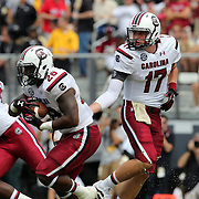 South Carolina Gamecocks quarterback Dylan Thompson (17) hands the football off to running back Mike Davis (28)the field during an NCAA football game between the South Carolina Gamecocks and the Central Florida Knights at Bright House Networks Stadium on Saturday, September 28, 2013 in Orlando, Florida. Thompson replaced starting quarterback Connor Shaw who was injured in the first quarter. (AP Photo/Alex Menendez)