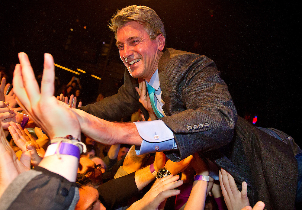 """Minneapolis Mayor R.T. Rybak crowd surfs on his supporters after a short speech during his """"Unauguration Party"""" at First Avenue, Wednesday, December 18, 2013."""