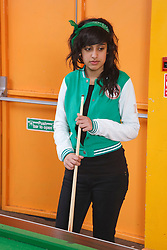 Girl with pool cue in Youth Club. Cleared for Mental Health Issues.