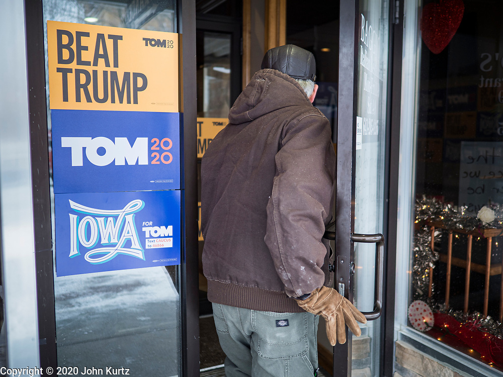 29 JANUARY 2020 - KNOXVILLE, IOWA: A man walks into a Tom Steyer campaign event in Knoxville, about 40 miles southeast of Des Moines, Wednesday. About 60 people attended the campaign meet and greet. Steyer, a California businessman, is campaigning to be the Democratic nominee for the US Presidency in 2020. Iowa holds the first selection event of the 2020 election cycle. The Iowa Caucuses are Feb. 3, 2020.          PHOTO BY JACK KURTZ
