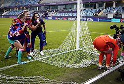 Barcelona players poses for photographs after cutting the goal net down after the final whistle during the UEFA Women's Champions League final, at Gamla Ullevi, Gothenburg. Picture date: Sunday May 16, 2021.