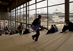 HANNOVER, GERMANY - MARCH-6-2008 - Visitors hang out on the large staircase in hall 9 at CeBIT, the world's largest computer fair, which attracts hundreds of thousands of visitors every year. (Photo © Jock Fistick)
