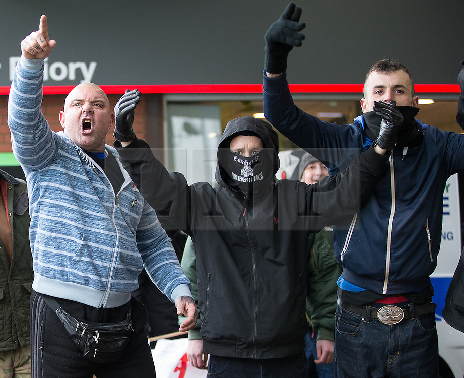© Licensed to London News Pictures . Kent , UK . SHANE CALVERT ( 34 , of Shadsworth Close , Blackburn ) (wearing Combat 18 face mask ) pictured at a far-right demonstration in  Dover on 30th January 2016 . Calvert has been convicted of violent disorder and sentenced to two-and-a-half years in prison for his role in violence that unfolded at the demonstration . Photo credit : Joel Goodman/LNP