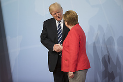 July 7, 2017 - Hamburg, Germany - German Chancellor Angela Merkel welcomes US President Donald Trump upon his arrival for the first common meeting of the G20 leaders at the Messe in Hamburg, Germany on July 7, 2017. (Credit Image: © Emmanuele Contini/NurPhoto via ZUMA Press)
