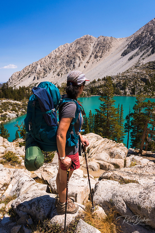 Backpacker at Big Pine Lake #2, John Muir Wilderness, Sierra Nevada Mountains, California USA