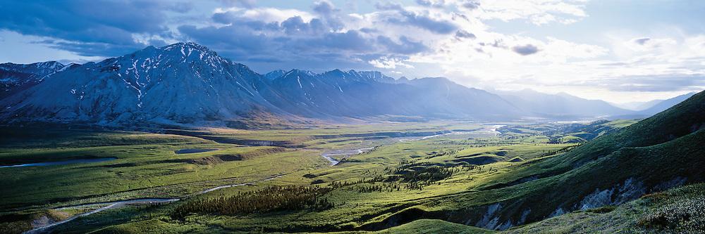 Midnight sun beams into the Snake River valley, Yukon