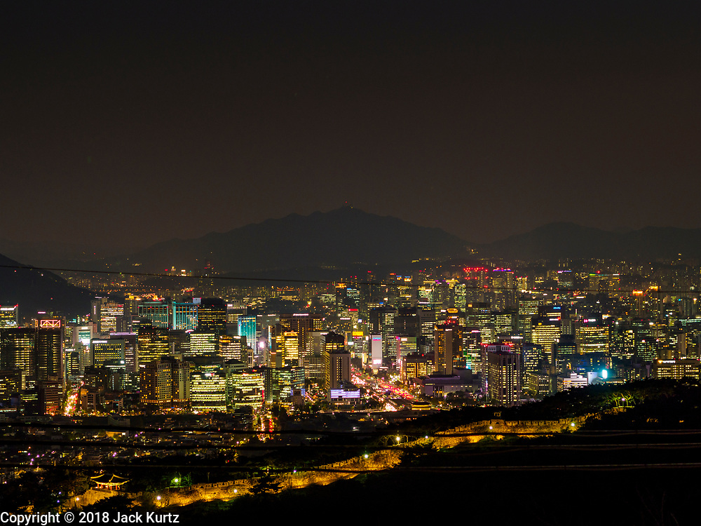 SEOUL, SOUTH KOREA:  The city of Seoul, just after sunset, as seen from Samcheong Park, north of downtown, above the Gyeongbokgung Palace and Blue House.     PHOTO BY JACK KURTZ
