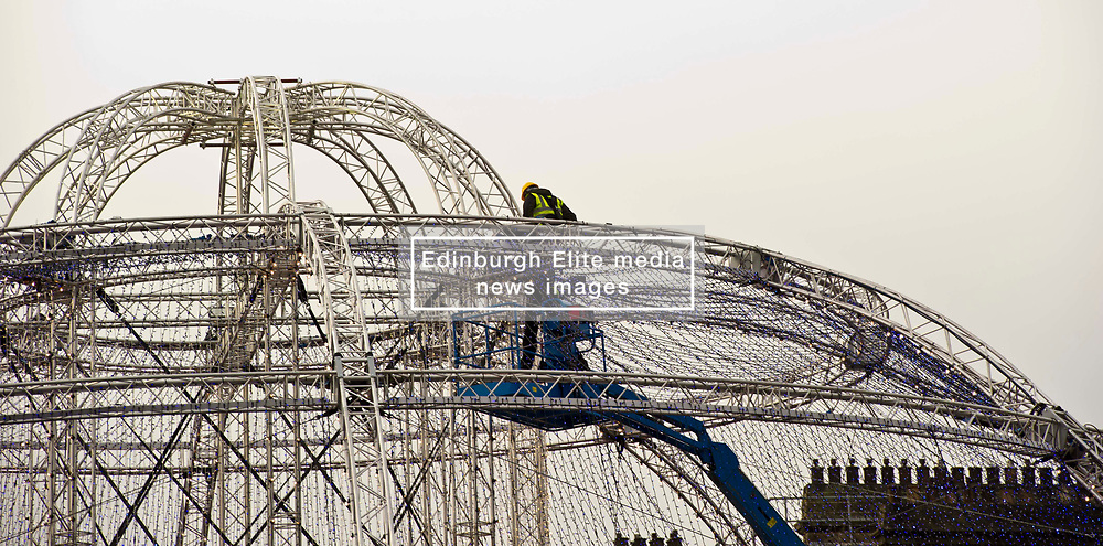 Pictured: <br /> Edinburgh's George Street has been changed into a pedestrian thoroughfare for the festive season and workmen with a head for heights have been busy decorating the street for the festivities.<br /> <br /> <br /> Ger Harley   EEm 14 November 2017