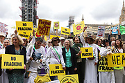 Baroness Jenny Jones , Caroline Lucas MP stand with Lancashire women. Up to a hundred women from the Lancashire anti-fracking movement dressed as suffragettes congregate in Parliament Square and pay the Dep For Energy, Business and Industrial Strategy a visit, London, Unted Kingdom, September 12 2018