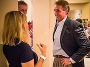 28 AUGUST 2012 - MESA, AZ:  Congressman JEFF FLAKE, (R-AZ) talks to supporters in his home in Mesa, AZ, on election night. Flake is the incumbent Congressman from Arizona's 6th Congressional District. He won the Republican primary for the US Senate seat being vacated by retiring Senator Jon Kyl. Flake faced Arizona businessman and political newcomers Wil Cardon in the primary and won handily.    PHOTO BY JACK KURTZ