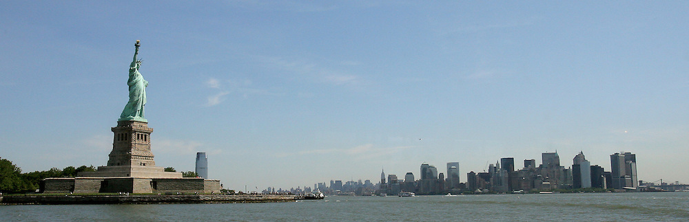 A view of the Statue of Liberty (L) and the skyline (R) in New York Harbor in New York, New York on 21 June 2007. The 46.84 meter tall statue, which was given to the United States by France on 4 July 1884, is one of 21 sites around the world being voted on to be the new 7 wonders of the world.
