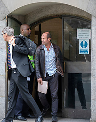 © Licensed to London News Pictures. 31/07/2018. London, UK. Former British soldier James Matthews (R) leaves the Old Bailey after terror charges against him for fighting with a Kurdish militia group against ISIS were dropped. Photo credit: Rob Pinney/LNP
