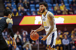 Jan 12, 2019; Morgantown, WV, USA; West Virginia Mountaineers guard Jermaine Haley (10) calls out a play during the second half against the Oklahoma State Cowboys at WVU Coliseum. Mandatory Credit: Ben Queen-USA TODAY Sports