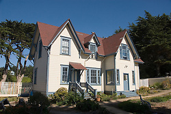Historic building at Montara Lighthouse, now a Youth Hostel..San Mateo Coast of California, south of San Francisco.  Photo copyright Lee Foster, 510-549-2202, lee@fostertravel.com, www.fostertravel.com.  Photo 421-31192