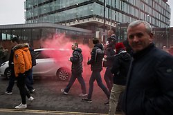 © Licensed to London News Pictures. 10/04/2018. Manchester, UK. Fans of Liverpool Football Club let off a flare in Manchester City Centre ahead of the Manchester City vs Liverpool Champions League quarter final match at the Etihad Stadium. Police have upgraded their operation covering the match after the Manchester City coach was attacked with flares and bottles by Liverpool fans, outside Anfield last week. Photo credit: Joel Goodman/LNP