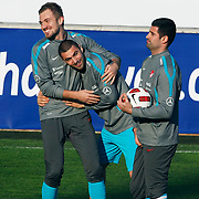 Turkey's national soccer team players Burak YILMAZ (C) and Gooalkeeper Volkan DEMIREL (R) during their a training session in Istanbul March 25, 2011. Turkey will face Austria in the UEFA Euro 2012 qualification soccer match on 29 March 2011.  Photo by TURKPIX