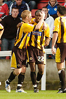 Photo: Leigh Quinnell.<br /> Swindon Town v Boston United. Coca Cola League 2. 30/09/2006. Bostons Dany N'Guessan is congratulated by his teammate Ritchie Ryan(L)