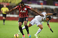 Jefferson Montero of Swansea city ® is challenged by Nedum Onuoha of QPR.Barclays Premier league match, Swansea city v Queens Park Rangers at the Liberty stadium in Swansea, South Wales on Tuesday 2nd December 2014<br /> pic by Andrew Orchard, Andrew Orchard sports photography.