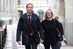 © Licensed to London News Pictures. 20/02/2017. LONDON, UK.  Gabby (Gabrielle) and Florian Kuehn outside Mayor's and City of London court in London for a hearing against their property management company, Victory Place. Gabby and Florian Kuehnn from Limehouse in east London claim they were told their pet dog, a Yorkshire terrier cross, Vinnie could live in their flat when they purchased it, but the management firm, Victory Place has subsequently insisted it has has a blanket no-pets policy. The animal rescue charity, All Dogs Matter are backing the couple and says no-pet rules see thousands of pets dumped each year and the rules are particularly unfair on the elderly and vulnerable who rely on pets for support and companionship.  Photo credit: Vickie Flores/LNP