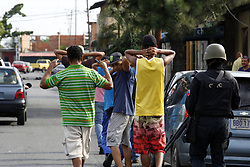 May 5, 2017 - Valencia, Carabobo, Venezuela - Police officers guard a group of detainees when implementing the Zamora security plan, in the Guacamaya area, south of Valencia. Area that was seriously affected by looting. Photo: Juan Carlos Hernandez (Credit Image: © Juan Carlos Hernandez via ZUMA Wire)