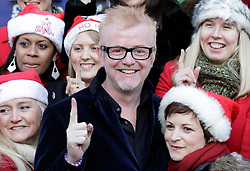 © Licensed to London News Pictures. 20/12/2011. London, United Kingdom .Chris Evans shows his support amongst the Military Wives Choir outside of HMV on Oxford Street to celebrate the success of the their single..Photo credit : Chris Winter/LNP