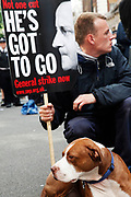 Peaceful protesters (and their dog) making their point by sitting down and discussing issues with passers by during the general strike march in central London. At this stage of the day this protest moved away from the main group and went up Whitehall where police contained the crowd.