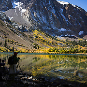 The Fall season in the Eastern Sierras is one of the most beautiful seasons to visit. Photographers at Parker Lake take photos of the fall colors.
